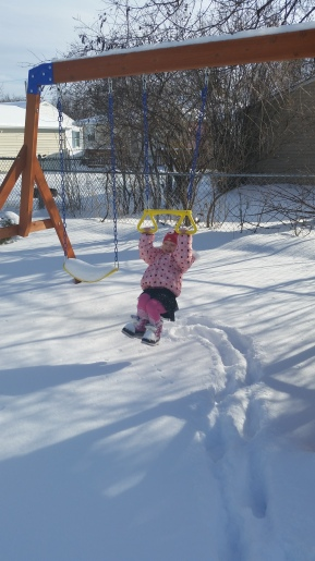 She couldn't help herself when we got back from the doctor's the other day. Had to play on a snowy swingset!